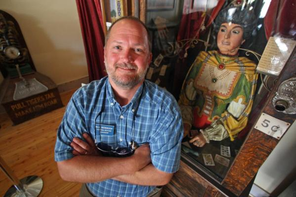 Bill Peterson, curator of Interpretation for the Montana Heritage Commission, poses for a photo near an antique Gypsy fortune teller machine, that sat for decades in a Virginia City restaurant and has received multimillion dollar offers from curators including magician David Copperfield.