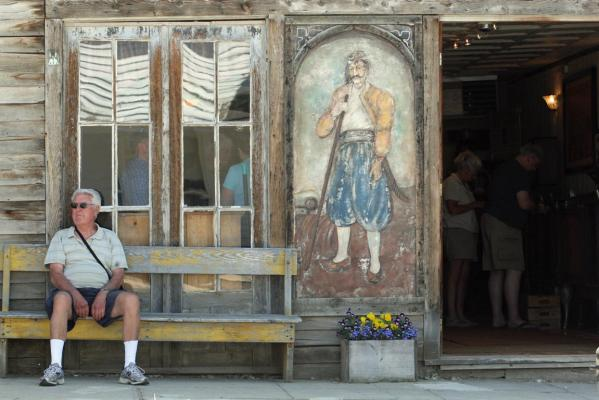 A visitor sits outside the Gypsy Museum which houses an antique Gypsy fortune teller machine, in Virginia City and has received multimillion dollar offers from curators including magician David Copperfield.