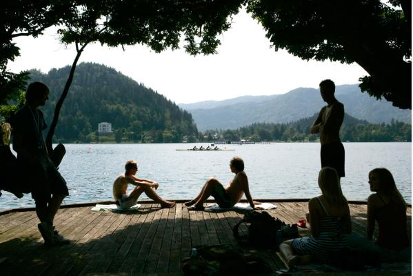 Spectators in a prime position to watch the rowing world championships on Lake Bled.