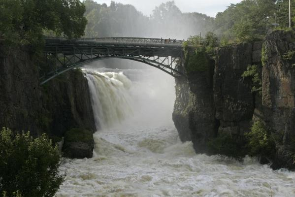 Water from the swollen Passaic River pours over the Great Falls in Paterson, New Jersey.