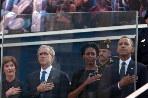 US President Barack Obama, first lady Michelle Obama, former president George W. Bush (2nd L) and Laura Bush salute the flag during tenth anniversary ceremonies at the National September 11 Memorial at the World Trade Center site, New York.
