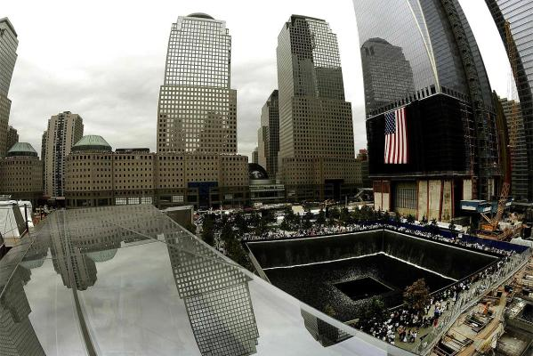 Family members gather around the North Pool during the dedication ceremony for the 9/11 National Memorial and tenth 9/11 Attacks anniversary ceremonies at the World Trade Center site in New York.