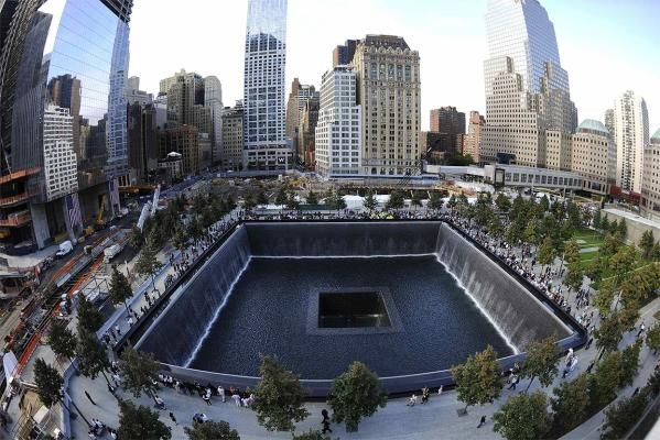 Families visit the South Memorial Pool during tenth anniversary ceremonies at the World Trade Center site in New York, September 11, 2011.