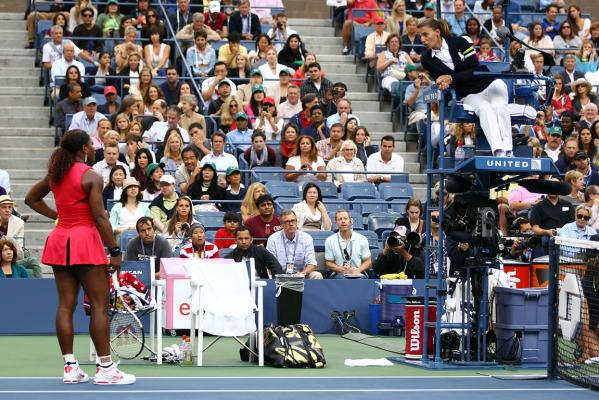 Serena Williams engages in debate with umpire Eva Asderakia during the US Open women's singles final.