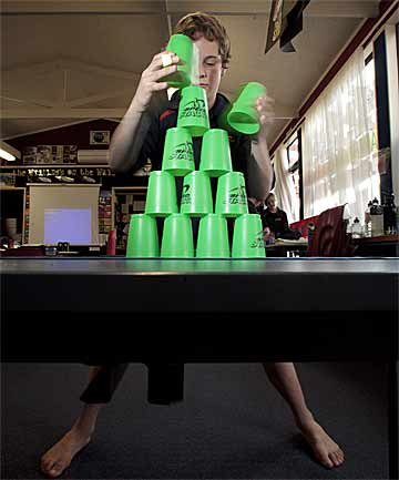 STACK 'EM: Whakarongo School student Alex Jones, 12, practises his speed stacking.