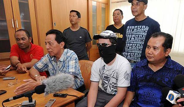 The Australian teenager charged with drug offences in Bali attends a press conference after movi