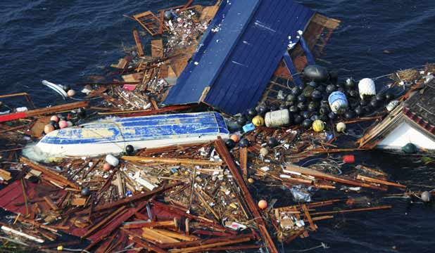 Debris floats in the Pacific Ocean in this photograph ta