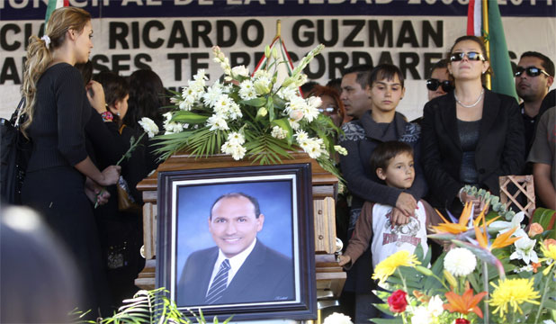 The funeral service for Ricardo Guzman, mayor of La Piedad. Guzman was the twenty-fifth mayor to be killed in Mexico since 2006.