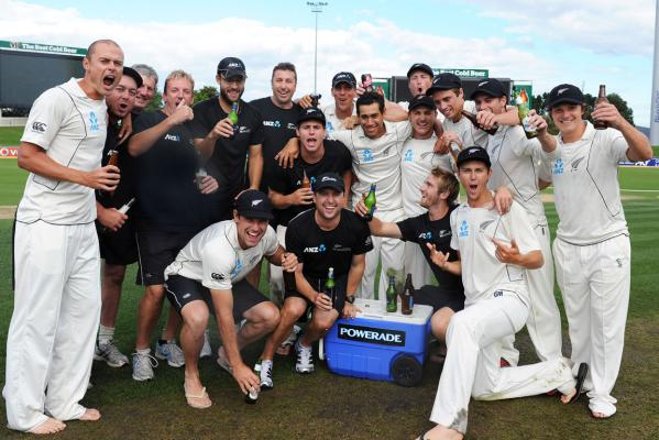 New Zealand players celebrate after beating Australia in the second cricket test match at Bellerive Oval in Hobart.