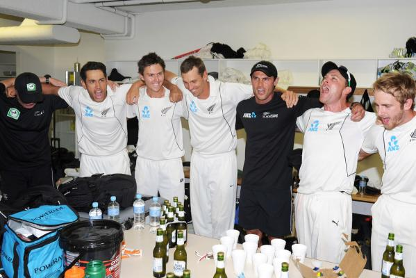 New Zealand players celebrate after beating Australia in the second c