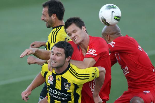 Wellington's Tim Brown competes in the air with Nigel Boogaard of Adelaide.
