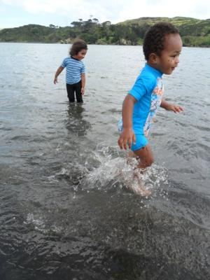 PADDLE POWER: From left, Talei, 3, and Gabby Raglan, 2, enjoy a day at the beach.