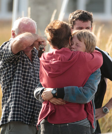 Friends and family gather at the scene of yesterday's hot air balloon tragedy at Carterton, which claimed 11 lives.