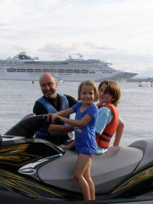 Summer fun: Lynda Hall snapped Darren and Emily Anderson and Benjamin Hall ready to get the jet ski going at Pilot Bay, Mt Maunganui.