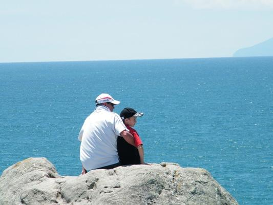A quiet moment: Dawn Daniels captured Mike and Thomas Daniels in a nice father, son moment at Mt Maunganui on Christmas Day.