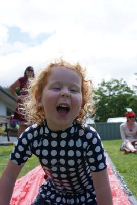 Shout out:  Aaron Martin caught Naomi Martin, 4, making some noise, in Tauranga, on Christmas Day.