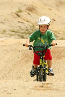 TOUGH RIDE: Lisa Vanin captured Sam Jack making the most of a rare glimpse of sun at a bike track.
