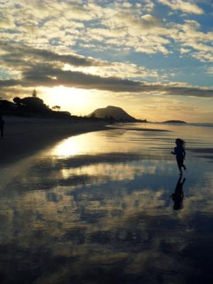 THE SUN SETS: Brooke Henkelman caught cousin Eden running along Omanu Beach, Mt Maunganui.
