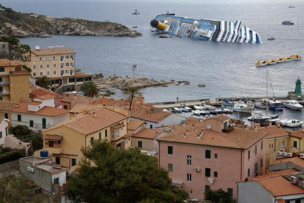 A view of the Costa Concordia cruise ship that ran aground off the west coast of Italy, at Giglio island.