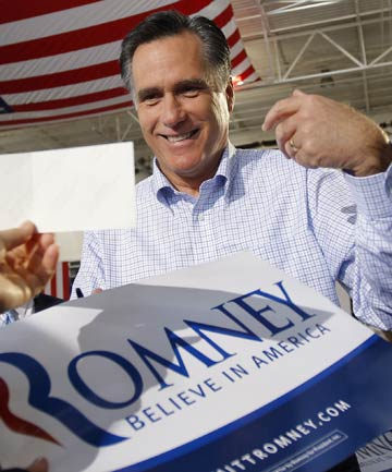 Republican presidential candidate and former Massachusetts Governor Mitt Romney greets audience members at a campaign stop in Florida.