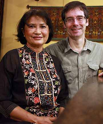 Kethana Dunnet, pictured with husband Bruce, believes her eight siblings and parents were killed by the Khmer Rouge. She hasn't heard from them since 1974.