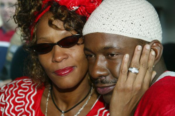 Whitney Houston and then husband Bobby Brown pose for photographers in 2003.