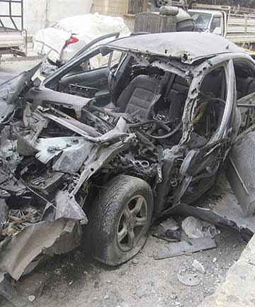 A damaged car is seen in Bab Amro, in the city of Homs.