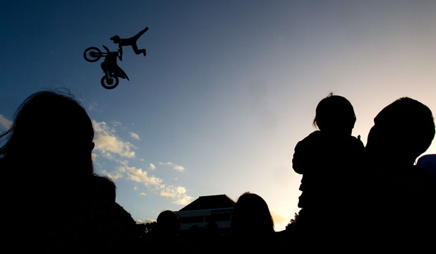 Freestyle motocross star Levi Sherwood takes to the air along with other riders in a demonstration show held in The Square, Palmer