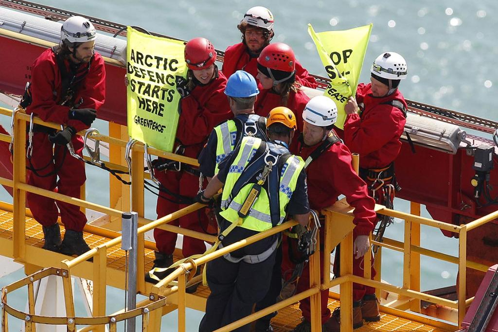Police move to arrest protesters aboard the Noble Discoverer.