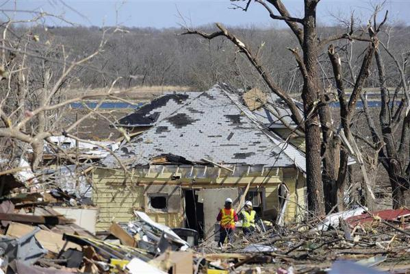 Rescue workers survey the damage after a tornado hit in Harveyville, Kansas.