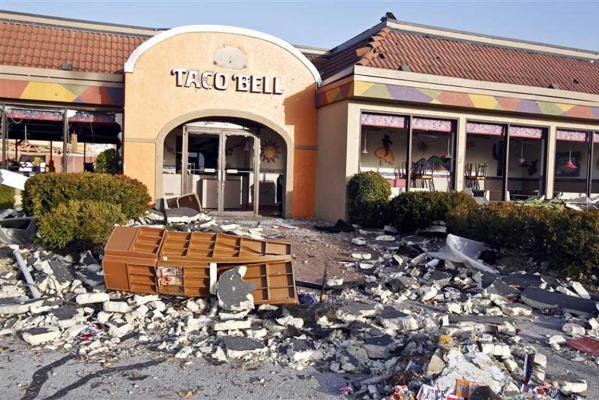 A storm damaged Taco Bell restaurant is seen on the Strip in Branson, Missouri.