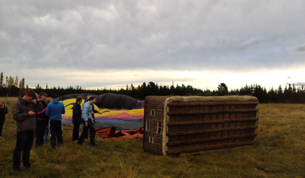Passengers gather their thoughts at the site of the North Canterbury balloon crash on Saturday.