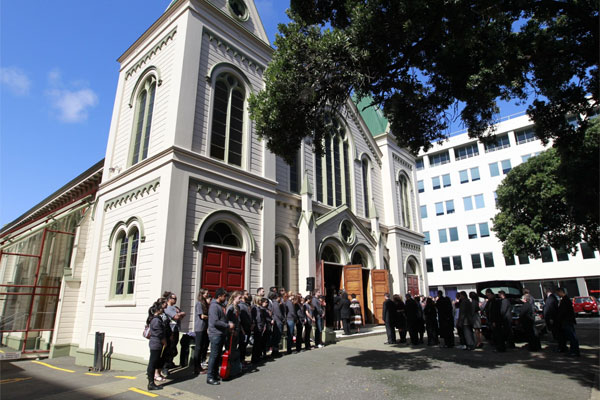 Mourners gather outside the funeral for Sir Paul Callaghan at Wesley Methodist Church in Taranaki street, Wellington.