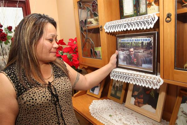 The mother of slain man Halatau Naitoko, Ivoni Fuimaono, with a photo of her son at her Papatoetoe home.