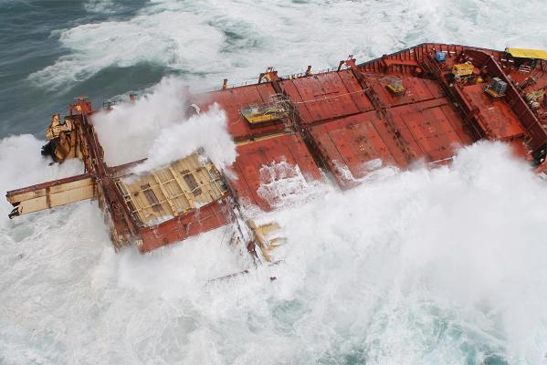 Large swells crash into the wreck of the Rena.