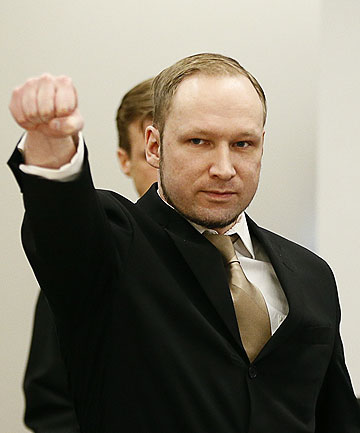 OPENING STATEMENT: Anders Behring Breivik raises his fist as he arrives to courtroom for the first day of his trial in Oslo.