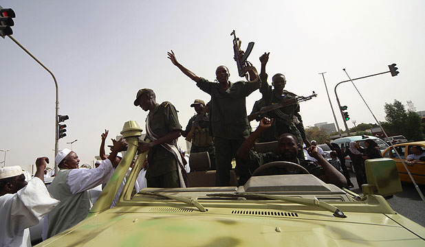 FEARS OF WAR: Sudanese soldiers celebrate the withdrawal of South Sudan from the disputed Heglig region, during a celebration march outside Sudan's Defence Ministry in Khartoum.