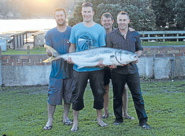 BIG CATCH: The fish herders, from left, Richard Hart, Steve Darby, David D