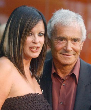 Vidal Sassoon (right) poses with his wife Ronnie as they arrive the opening of the first Stella McCartney boutique in Los Angeles in 2003.