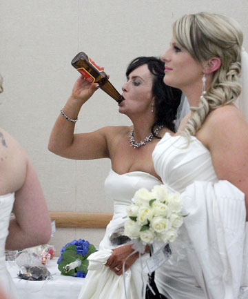 Hawera farm worker and March bride Katrina Hayman cools off with a swig of beer at the Taranaki Bride of the Year competition in New Plymouth on Saturday night.