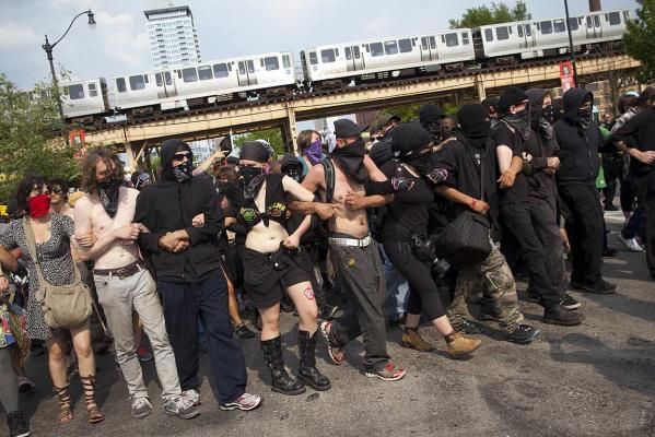 Members of the Black Bloc movement march during an anti-Nato protest march in Chicago.