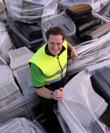 Ecodrop's Richard Simpson with waste monitors that will be stripped down.