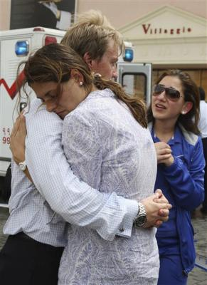 Family members of victims react in grief after a blaze at the Villaggio Mall in Doha's west end.