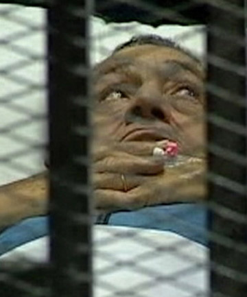 Former Egyptian President Hosni Mubarak is seen in the courtroom during his trial at the police academy in Cairo.
