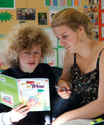 Jessie Woods, 14, with reading teacher Nicola Conza, has flourished at Salisbury School.