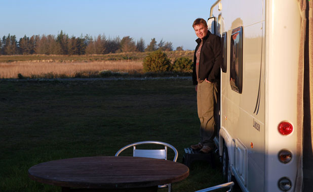 Glenn Mackle says he'll stay long-term in his caravan on his red-zoned vacant section in Brooklands.