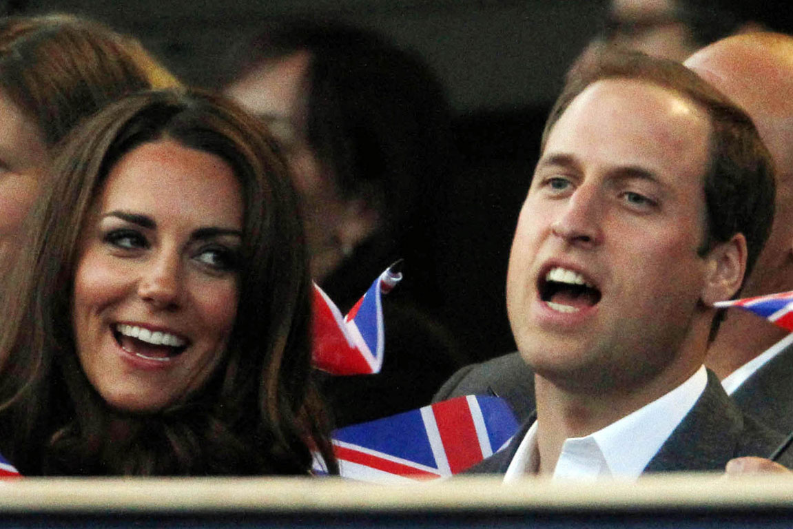 Britain's Catherine, Duchess of Cambridge and Prince William sing along d