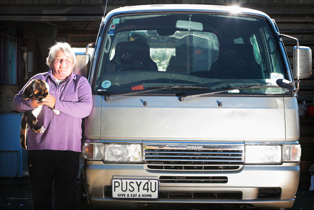 PUSSY LOVER: Norma Capper with cat Meeka, shows off her double entendred personalised plate which made it through the national screening process.