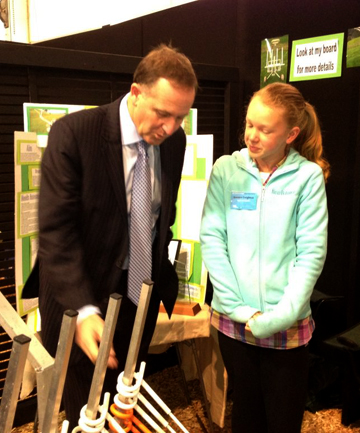 Jasmine Creighton, from Tauranga, shows her invention to PM John Key.