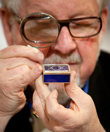 Jewellery consultant for Webb's Auction House Chris Devereaux looks over a genuine Faberge box found during an estate cleanout recently  in New Zealand. It could fetch up to $20,000.